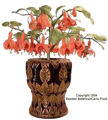 Fuchsia in Leaf Carved Container